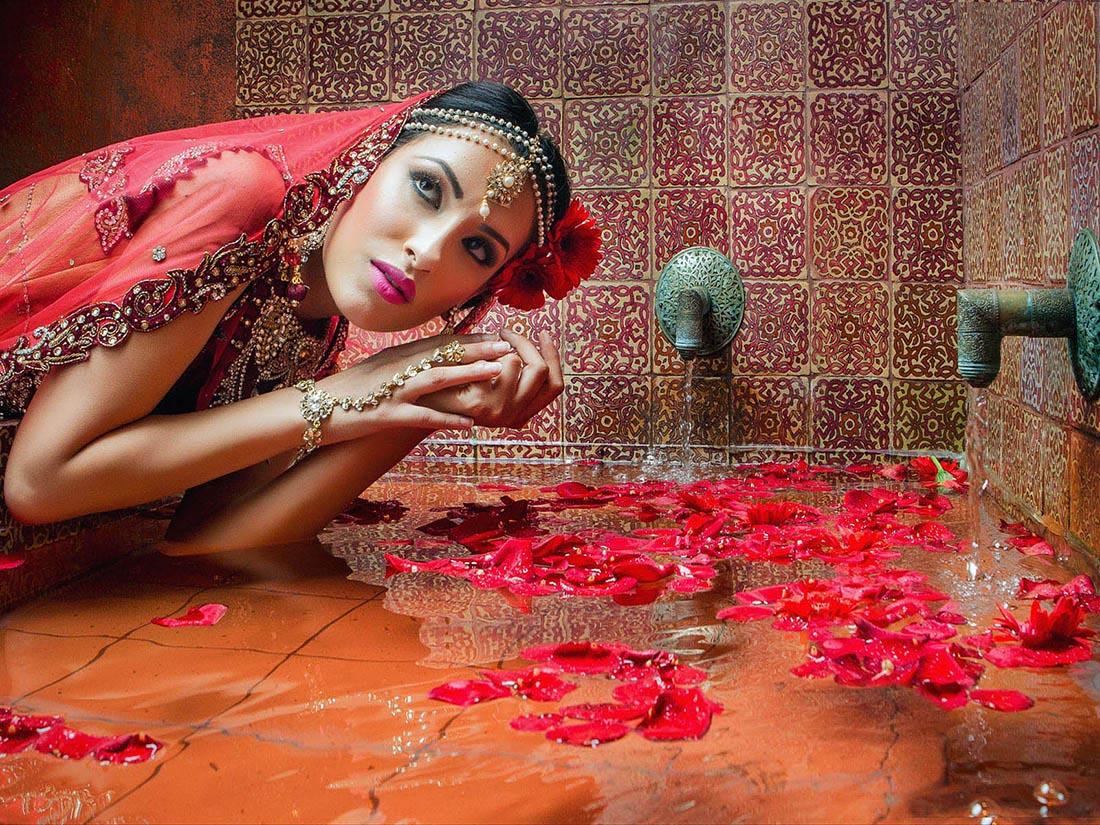 Asian bride photographed in wedding venue