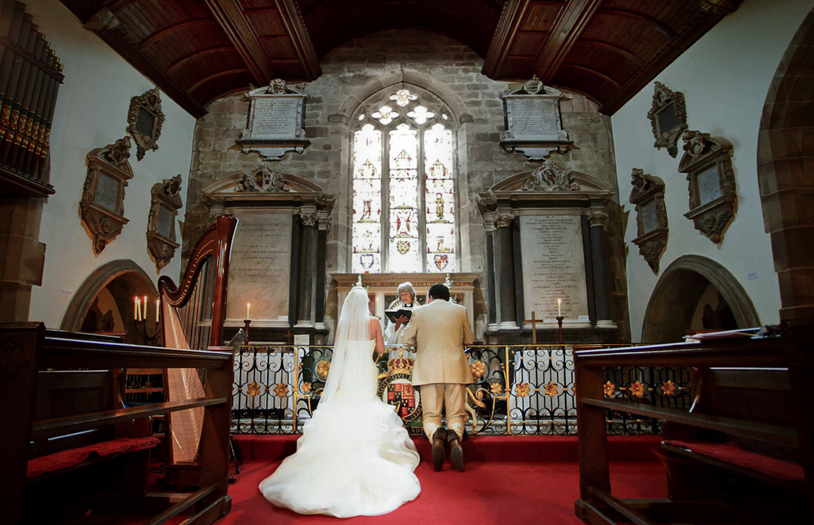 A ceremony snapshot - A couple is getting married in church