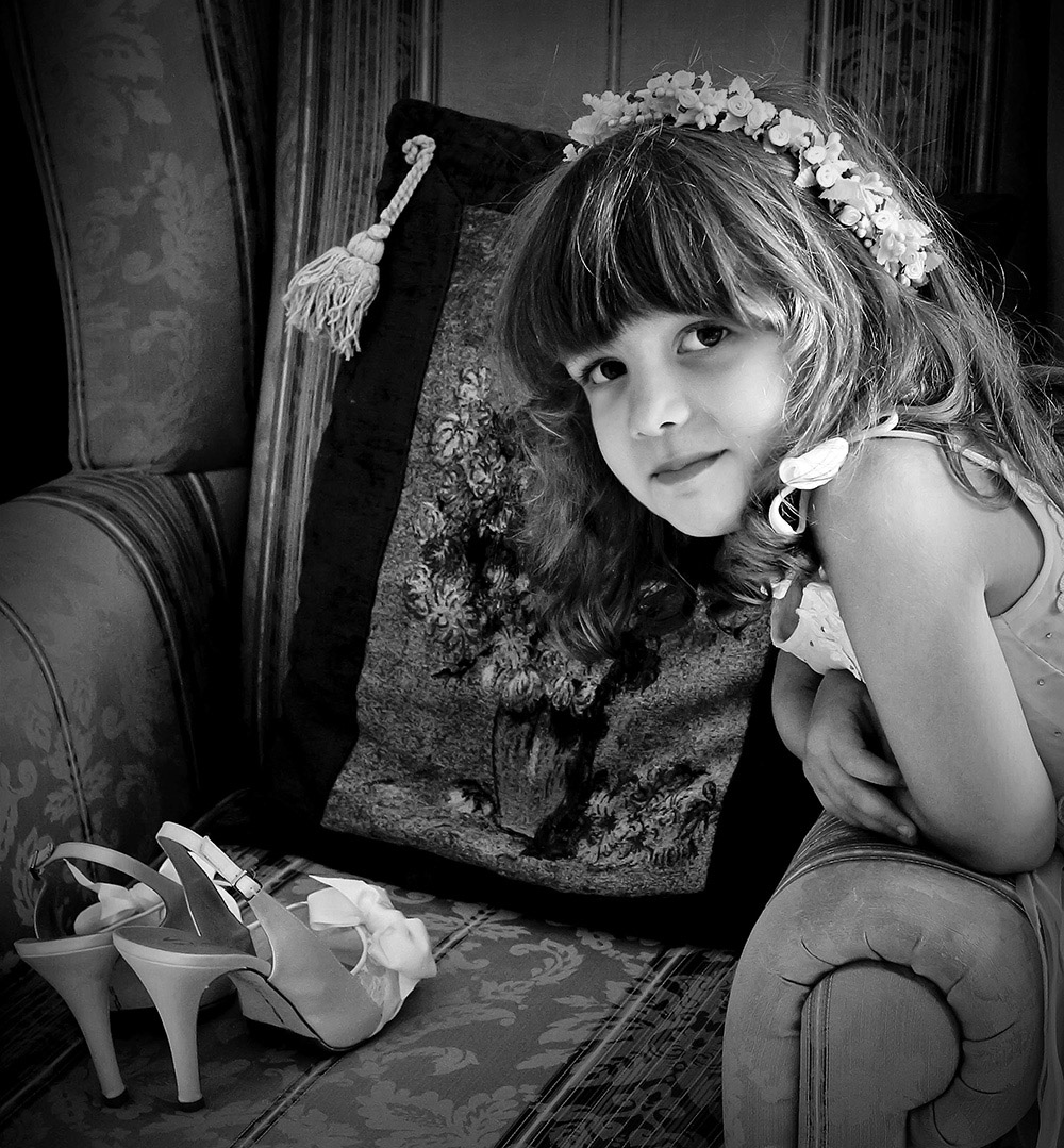 A girl and bridal shoes