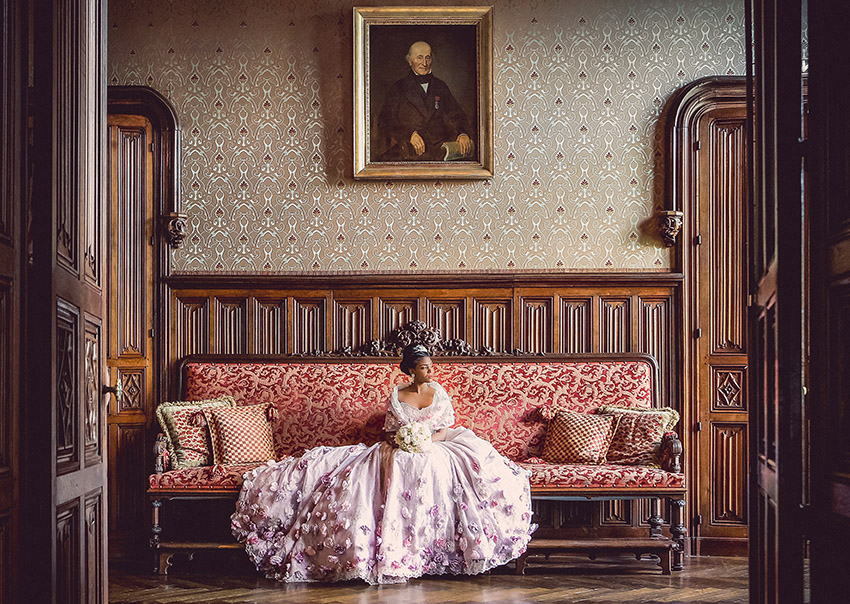 A bride sitting in Chateau de Challain