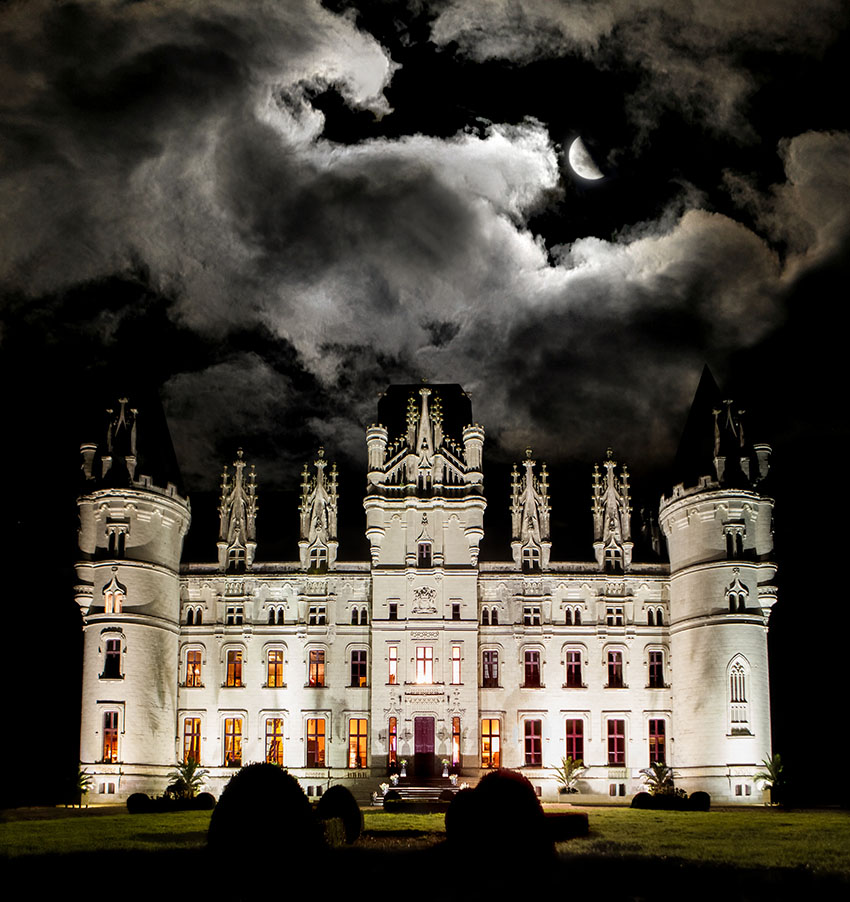 Chateau de Challain's front side at night