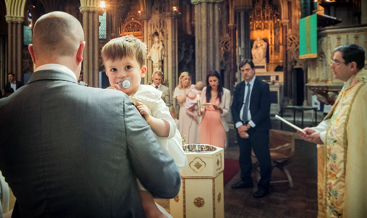 Christening photographer captures a candid after the baptism