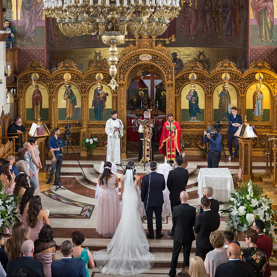 Greek ceremony captured by four Greek wedding photographers and video operators.